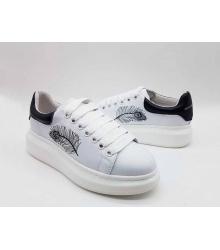 Женские кроссовки Alexander McQueen (Александр Маккуин) кожаные с пером с черным задником White
