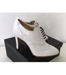 Ботильоны женские Chanel (Шанель) Cruise кожаные на каблуке шпилька White