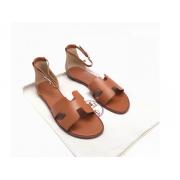 Женские сандалии Hermes (Гермес) Santorini кожаные на плоской подошве Brown